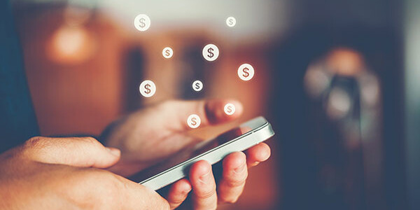 Man holding mobile phone with dollar signs